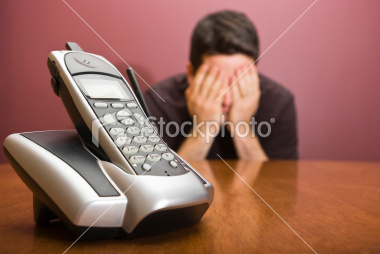 man-hides-his-face-waiting-for-the-phone-to-ring.jpg