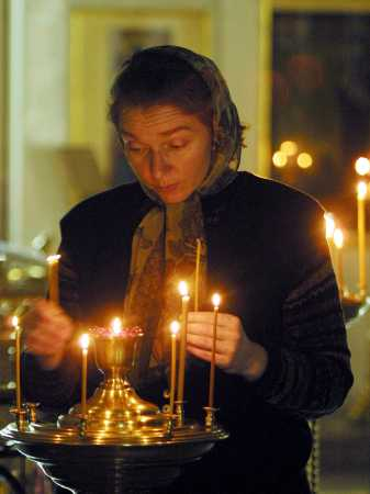 WomanPraying~Candles~Moscow.jpg