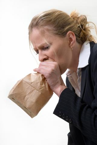 Woman_blow_into_paper_bag.jpg