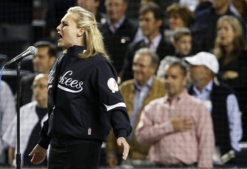 haley-swindal-grandaughter-george-steinbrenner-sings-god-bless-america-during-seventh-inning-yankee-stadium-new-york.jpg