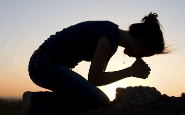 woman on knees in prayer.png